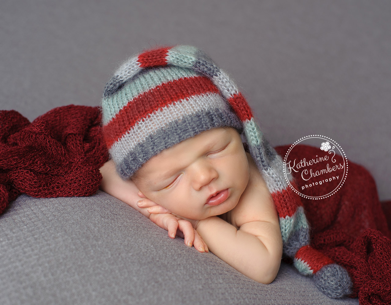 Cleveland Newborn Photographer, Holiday Newborn Photo, Chin on Hands Pose