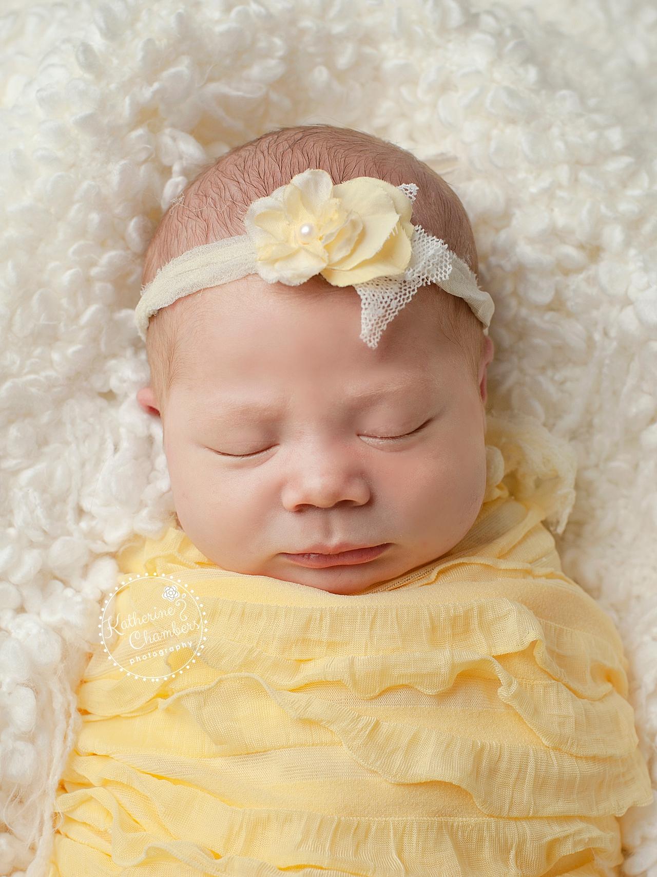 Newborn Baby in Yellow, Cleveland Baby Photographer, Studio Photography