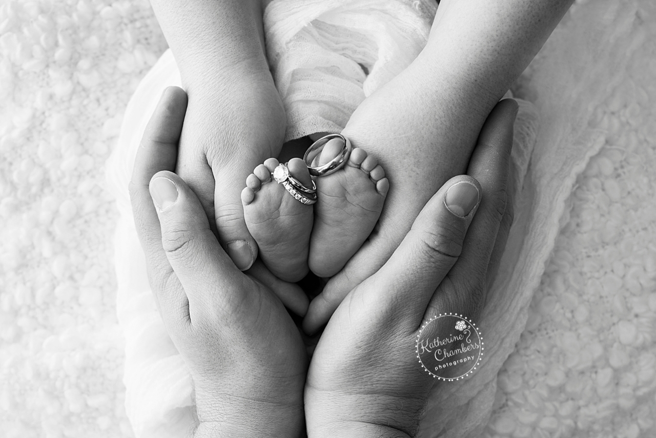 Newborn feet with Parents Hands